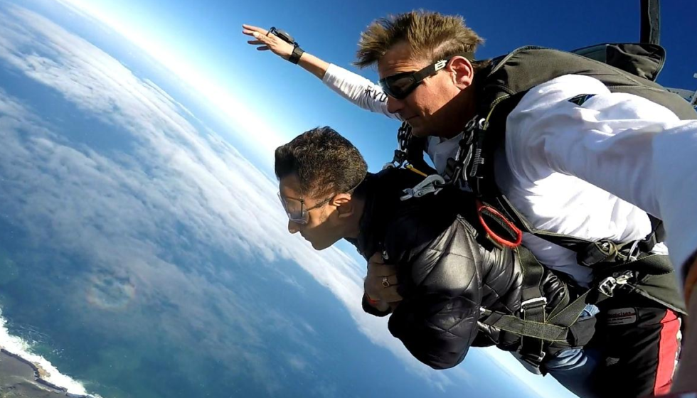 garden route activities - skydiving over scenic landscape